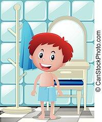 Boy standing in bathroom