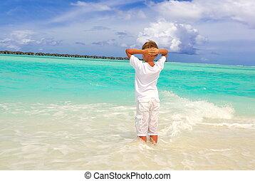 Boy standing in sea