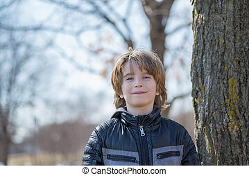 Boy standing in the alley in park