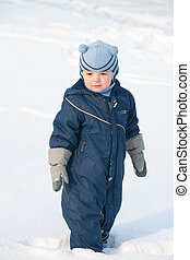 Boy standing on the snow field