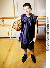 Boy standing with basketball