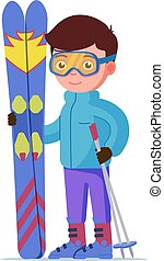 Boy standing with mountain skis and sticks