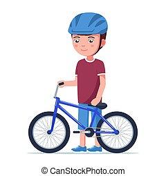 Boy stands with a bmx bike