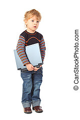 Boy stands with laptop in hands