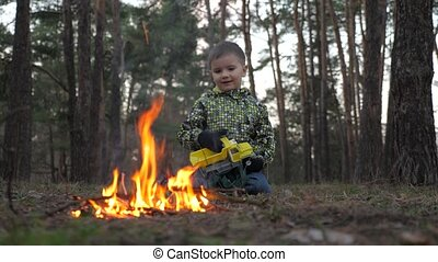 Boy staring at fireplace. Arson background. Beautiful kid...