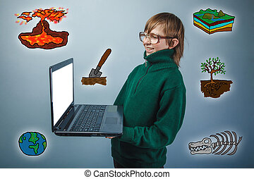 boy student holding a laptop geology science