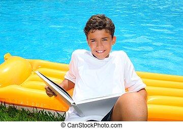 boy student teen vacation homework pool float smiling