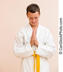 boy studying martial arts