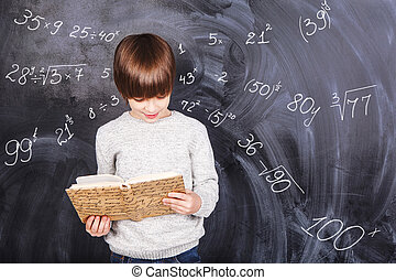 Boy studying mathematics - Thoughts of children against the...