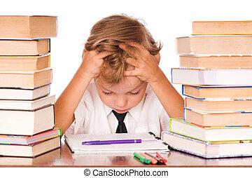 Boy studying - Portrait of a cute little boy sitting in...