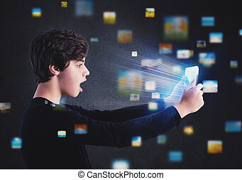 Boy surfs on internet with a tablet