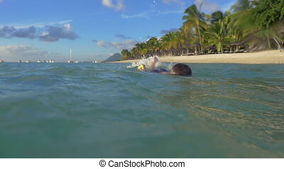 Boy swimming and diving in the sea