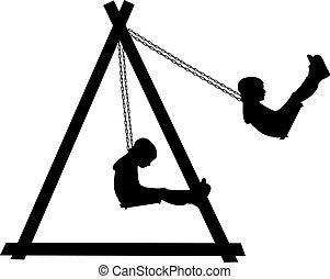 Boy swinging on a swing in the park