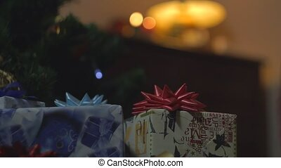 Boy Take New Year Gift under Christmass Tree