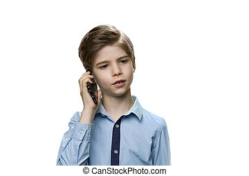 Boy talking on smartphone in blue shirt on white background.