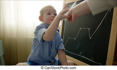 Boy Tearing a Hundred Dollars Banknote