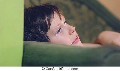 boy teenage is eating an orange and peel - boy teenage is...