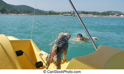boy teenager and woman. dog girl on a sailor bathe in the...