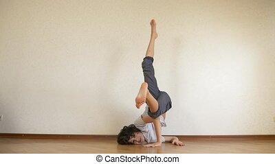 boy teenager, dancer break dance, trains in the dance hall....