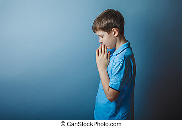 boy teenager European appearance in a blue shirt brown ...