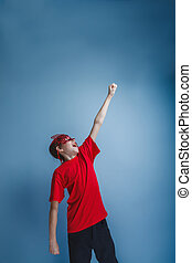 boy teenager European appearance in a red shirt brown in a red m
