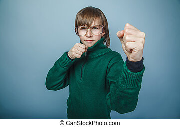 boy teenager European appearance in sunglasses green sweater