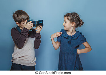 Boy teenager European appearance photographs teen girl on a...