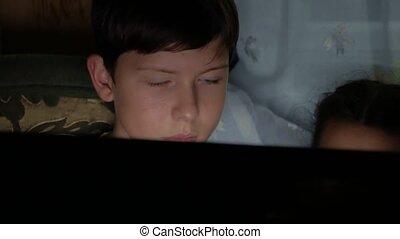 boy teenager laptop night communicates social media internet...