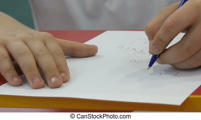 Boy teenager learns to write with left hand - Boy teenager...