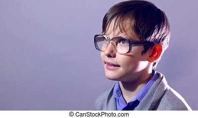boy teenager nerd portrait schoolboy glasses on purple background education