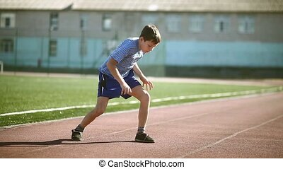 boy teenager playing sports stadium gymnastics warm-up...