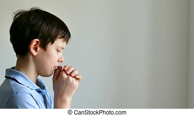 Boy teenager praying belief in god