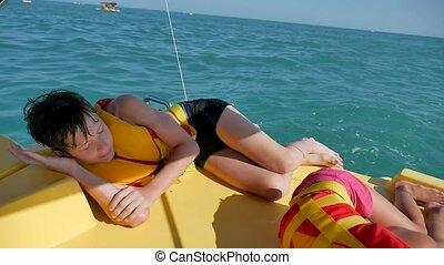 boy teenager sleeping on a boat in the sea. boy teenager...