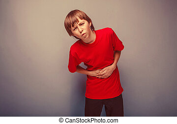 Boy teenager twelve years in the red shirt abdominal pain, ...