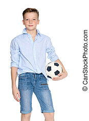 Boy teenager with a soccer ball.