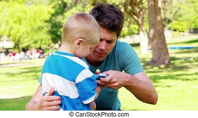 Boy telling who has broken his toy