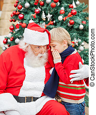 Boy Telling Wish In Santa Claus's Ear - Boy telling wish in...