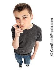 Boy thinking or pondering