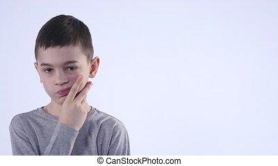 Boy thinking over white background