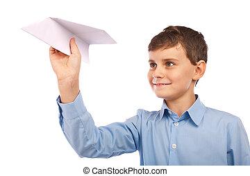 Boy throwing a paper plane