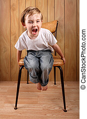 Boy throwing a tantrum while on a time out - a young boy...