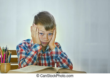 Boy tired to read a book