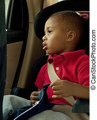 boy toddler sitting in carseat - african american boy ...