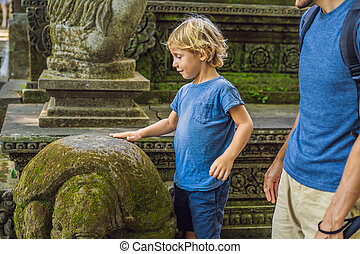 Boy tourist discovering Ubud forest in Monkey forest, Bali Indonesia. Traveling with children concept