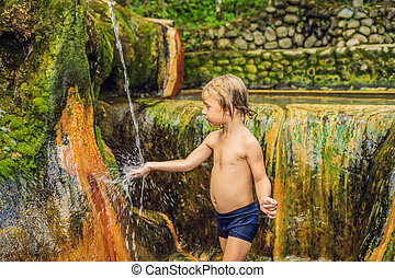 Boy tourist in Belulang Hot Springs in Bali, Village ...