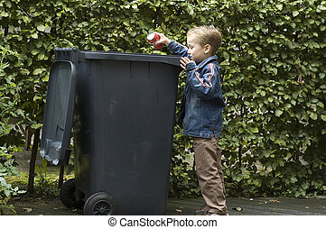 Boy Trashing A Can - Boy wanting to throw a can in the ...