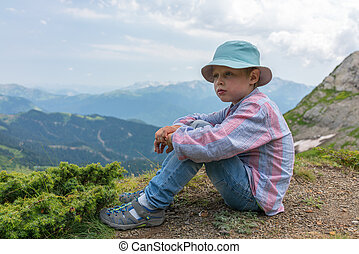 Boy-traveler in panama is resting on the top of the mountain.