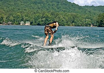 Boy Turning on Trick Skis