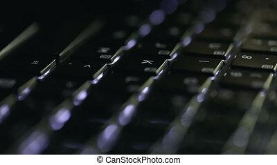 Boy Types on Black Keyboard - Young boy typing on black...