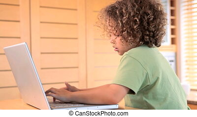 Boy typing on a laptop